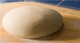 How do leavening agents make dough rise?