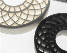 The photo shows two airless tires that were created with 3D printing technologies using thermoplastic polyurethane from BASF.