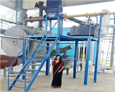 Paterson Energy Founder Vidya in front of the plastic-to-fuel plant.